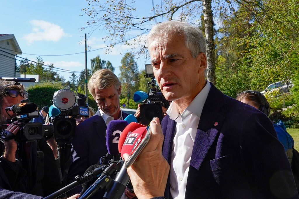 Labor leader Jonas Gahr Store answers questions from reporters outside his home, the day after the parliamentary election in Oslo, on Sept. 14, 2021.