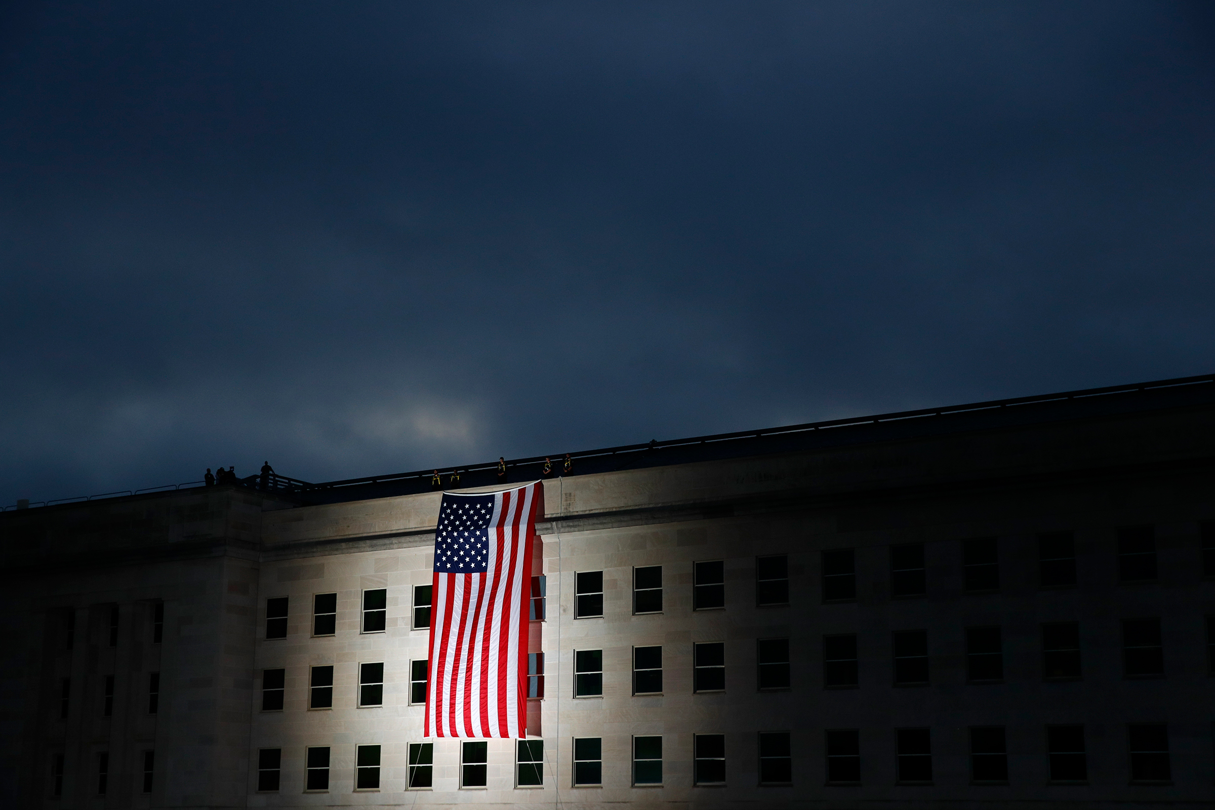 An American flag is unfurled at sunrise at the Pentagon in Washington, D.C., on Sept. 11, 2019, the 18th anniversary of the attacks.