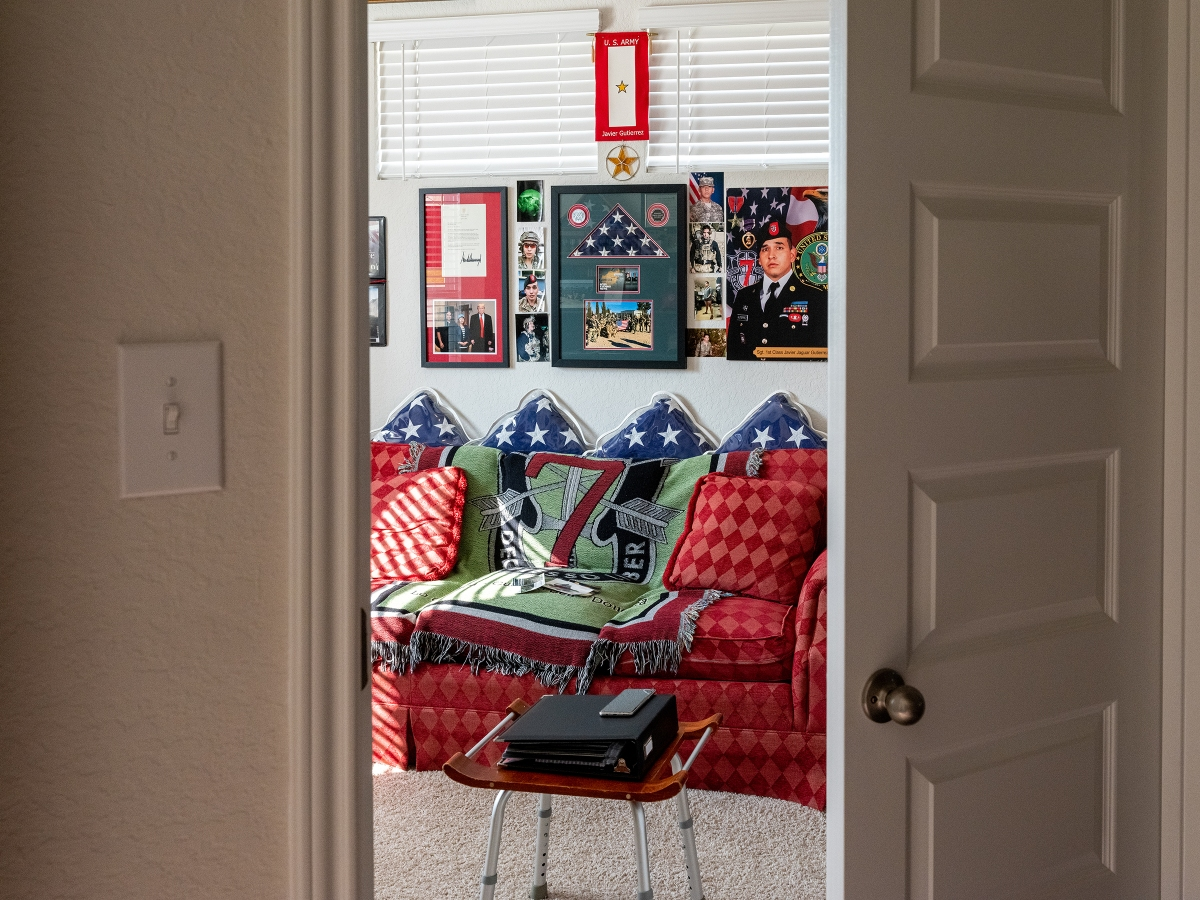 The sunroom in the Gutierrez family's two-story brick home in San Antonio is decorated with remembrances of their fallen son.