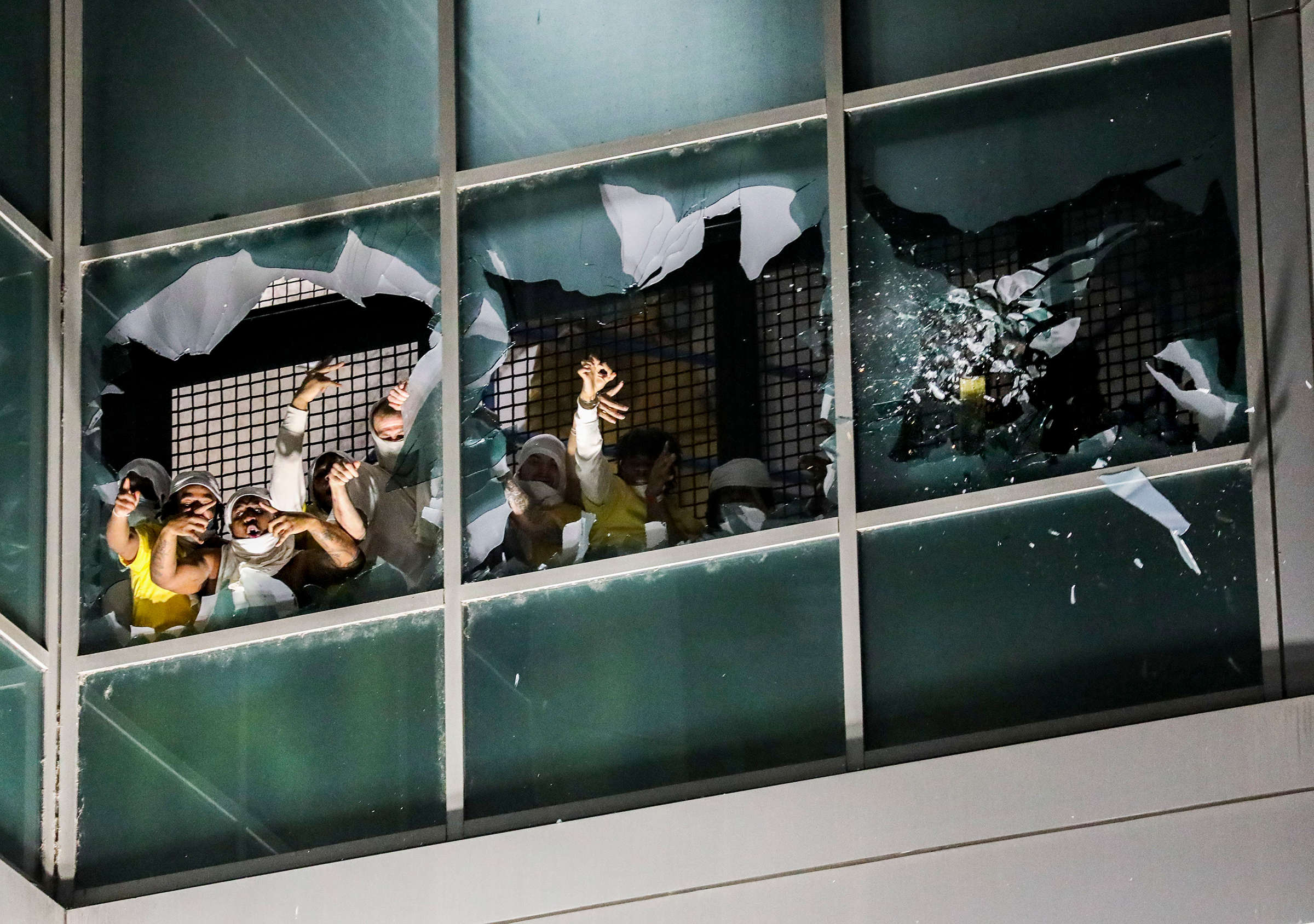 Prisoners in a cell block break windows and chant in protest at the St.Louis City Justice Center, on April 4.