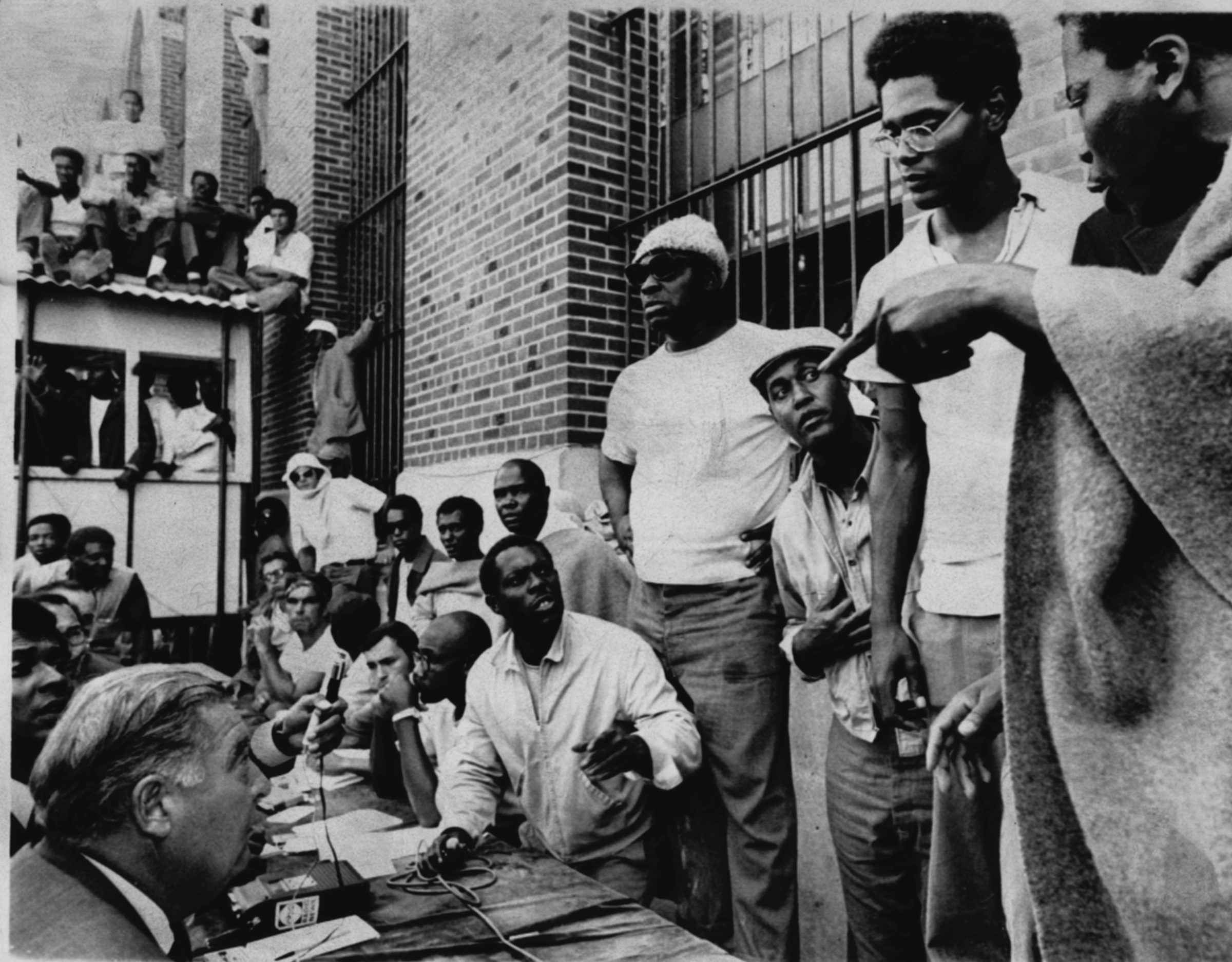 Attica prisoners, right, negotiate with State Commissioner of Corrections Russell Oswald, Sept. 10, 1971.
