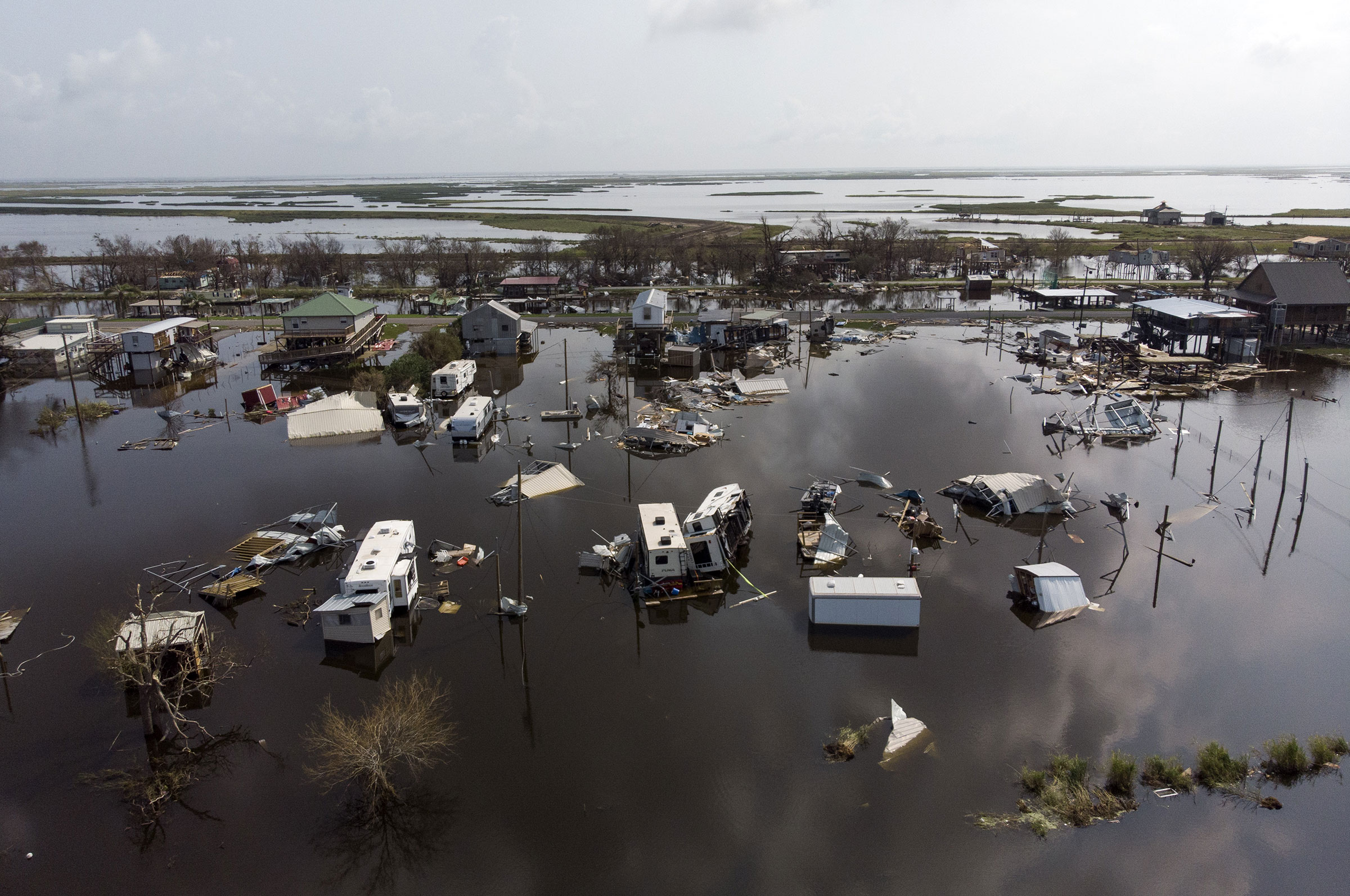 Damaged homes in floodwater after Hurricane Ida in Pointe-Aux-Chenes, Louisiana, U.S., on Thursday, Sept. 2, 2021.