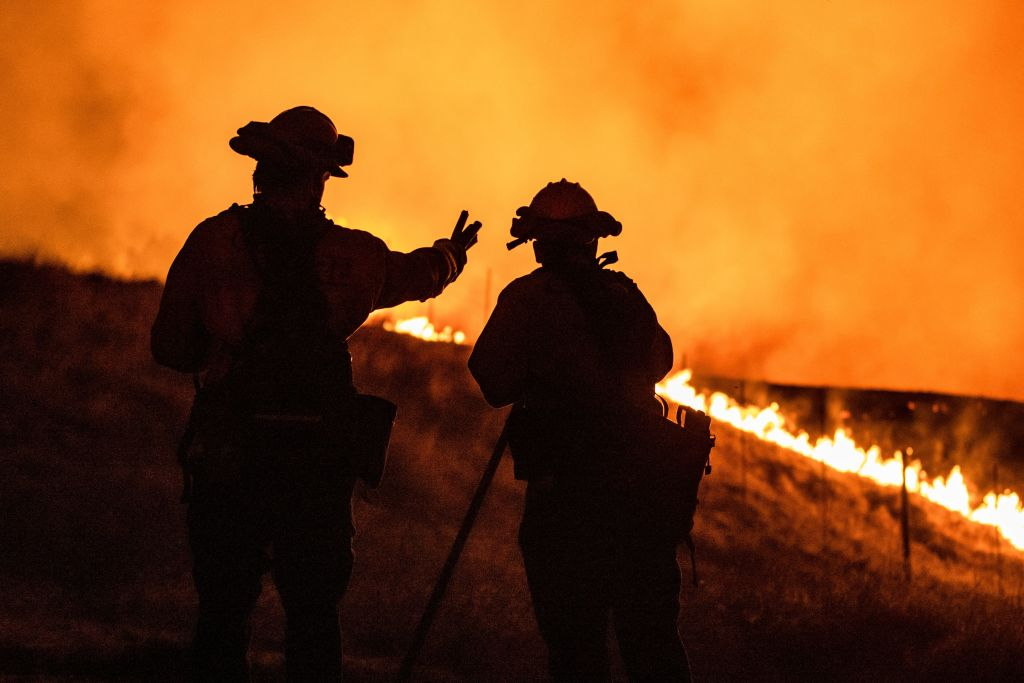 Fire fighters keep watching an approaching fire line on the outskirts of Santa Rosa, Calif., on September 27, 2020.