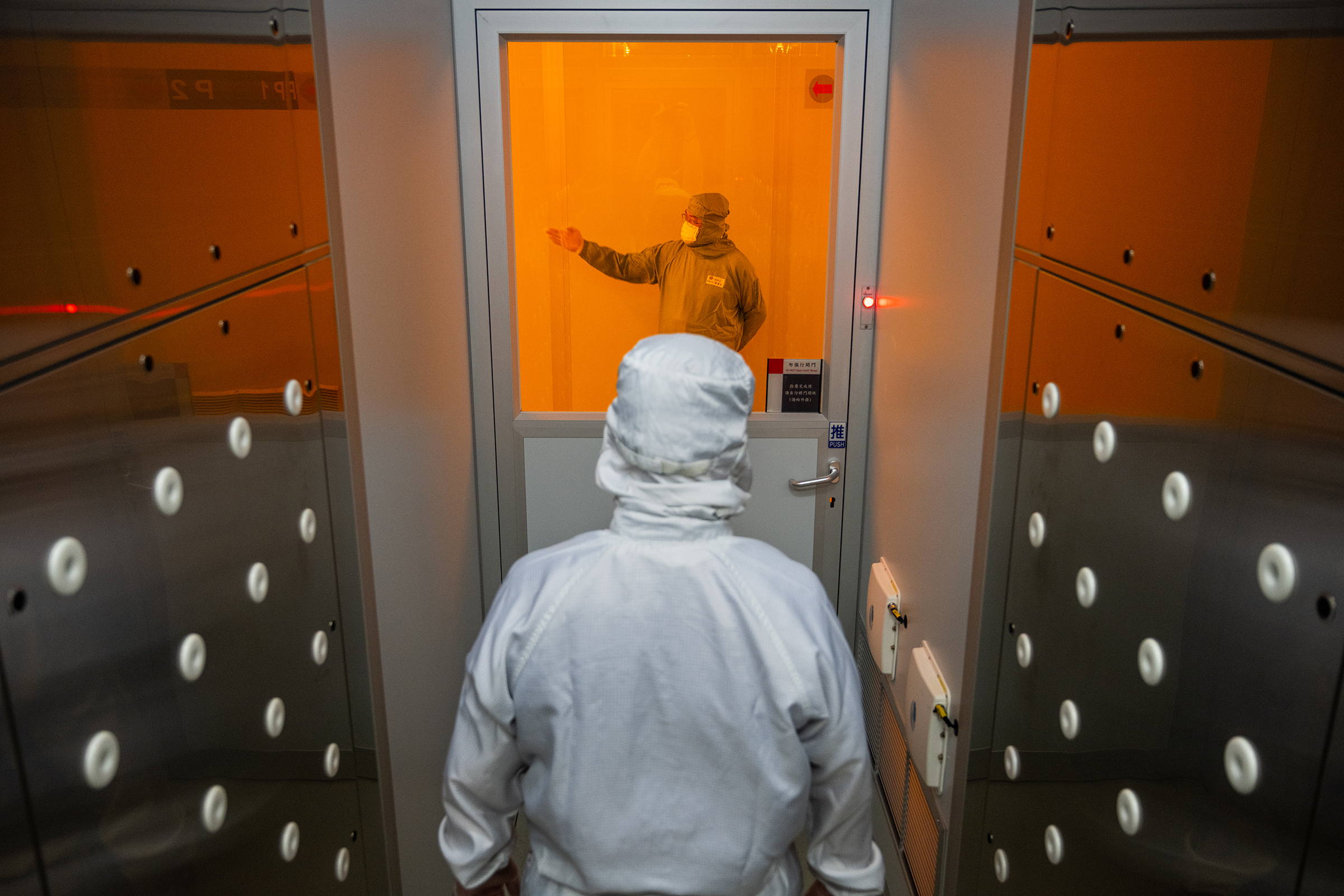 """A worker enters a """"cleanroom"""" at chipmaker TSMC's headquarters in Hsinchu, Taiwan, on Sept.10"""