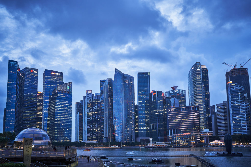 Buildings are illuminated at dusk in the central business district (CBD) of Singapore, on Jan. 28 2021.