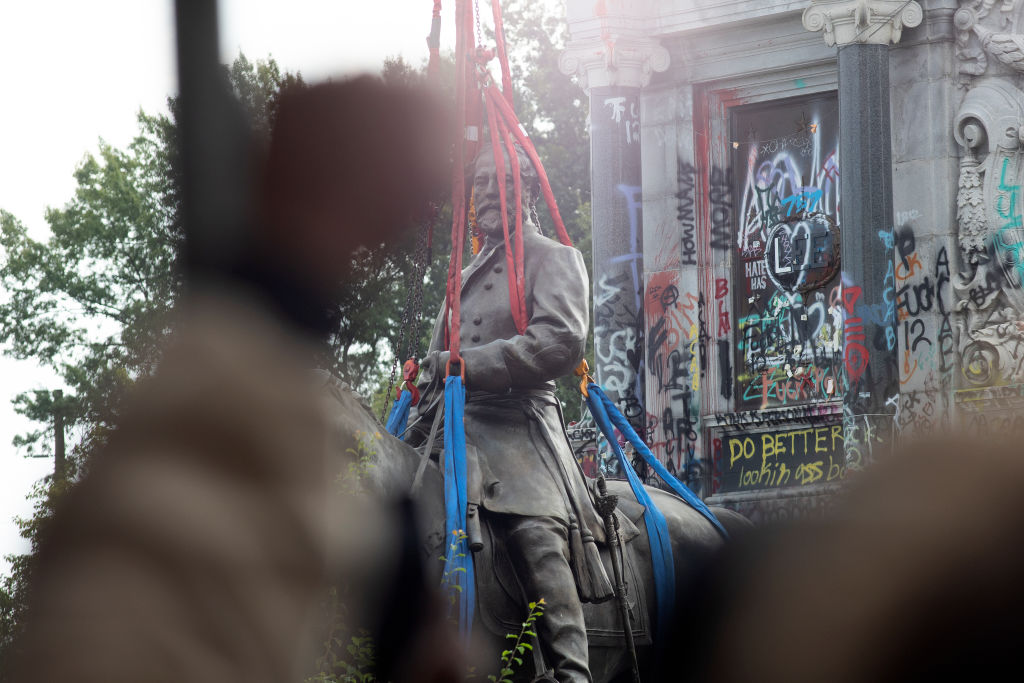 The statue of Confederate General Robert Lee is removed at Monument Avenue on Sept. 8, 2021 in Richmond, Va.
