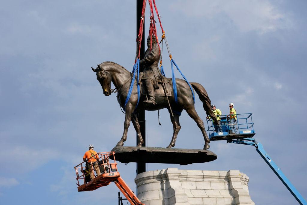 Crews remove a statue of Confederate General Robert E. Lee on Monument Avenue, Sept. 8, 2021, in Richmond, Va.