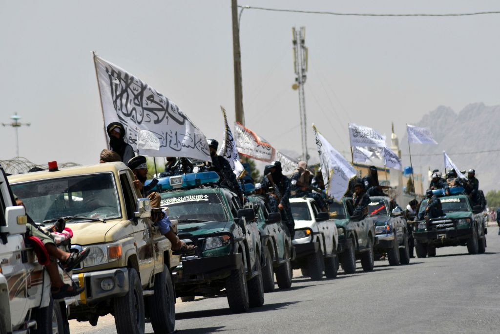 Taliban fighters atop vehicles with Taliban flags parade along a road to celebrate after the US pulled all its troops out of Afghanistan, in Kandahar on Sept. 1, 2021 following the Talibans military takeover of the country.