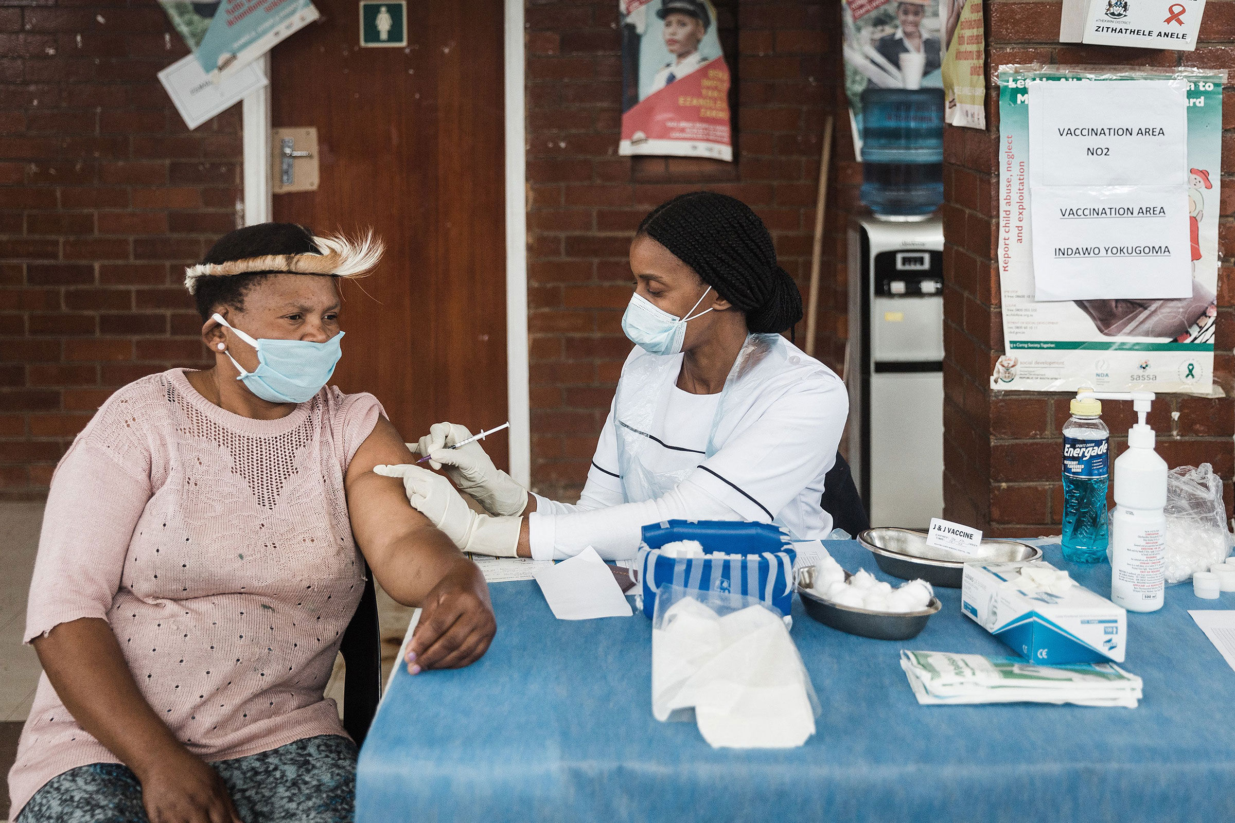 A woman looks on as she receives the Johnson and Johnson vaccine from Sister Nomhosi Msibi during the launch of the VaxuMzansi National Vaccine Day Campaign at the Gandhi Phoenix Settlement in Bhambayi township, north of Durban , on Sept. 24, 2021.