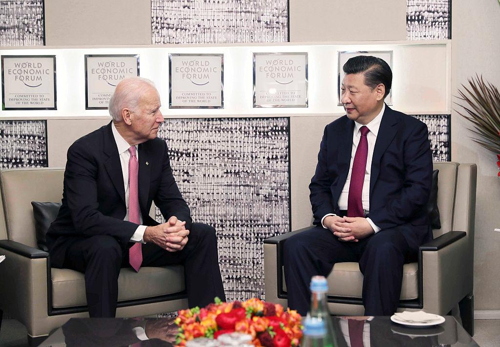 Chinese President Xi Jinping meets with then-Vice President Joe Biden in Davos, Switzerland, Jan. 17, 2017.