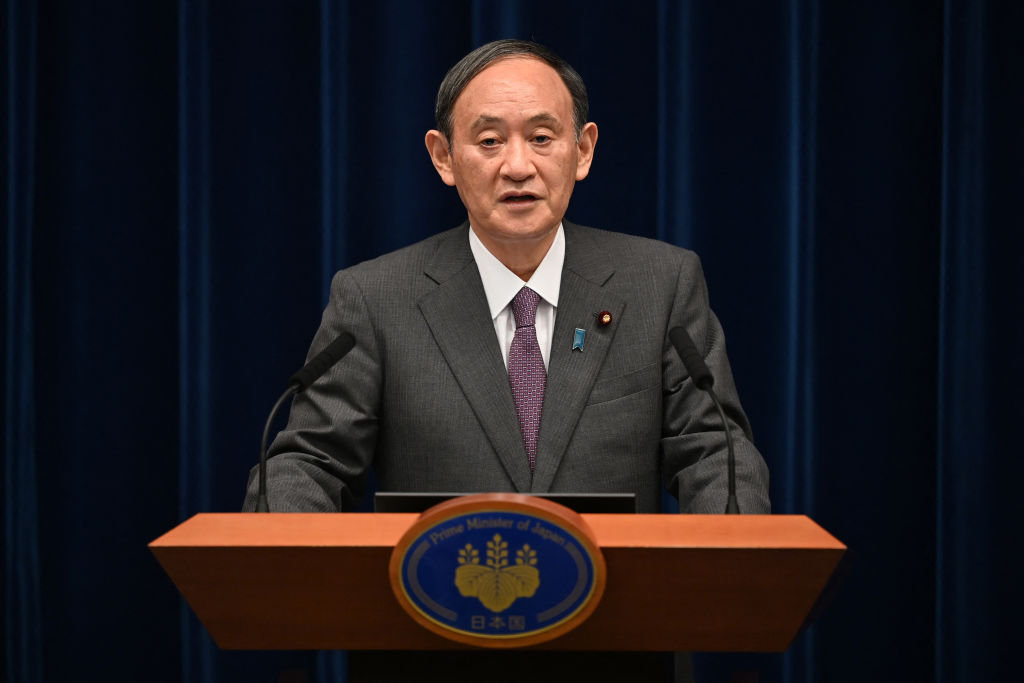 Japan's Prime Minister Yoshihide Suga speaks during a news conference at the prime minister's office in Tokyo on August 25, 2021.