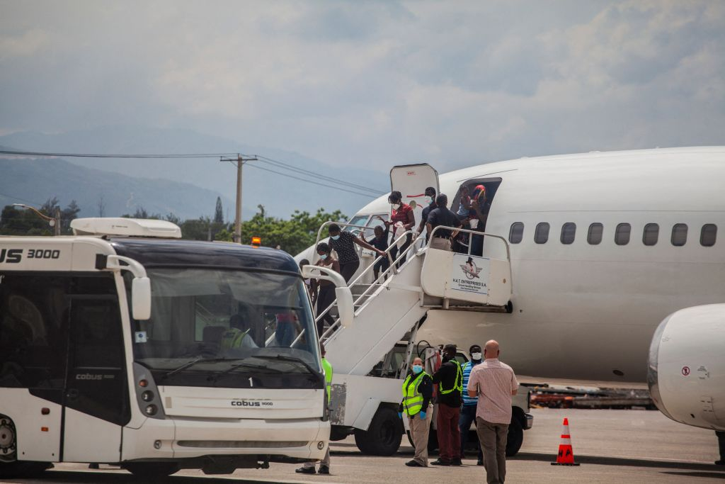 Haitian migrants expelled from the U.S. arrive on September 19, 2021 at the airport in Port au Prince.