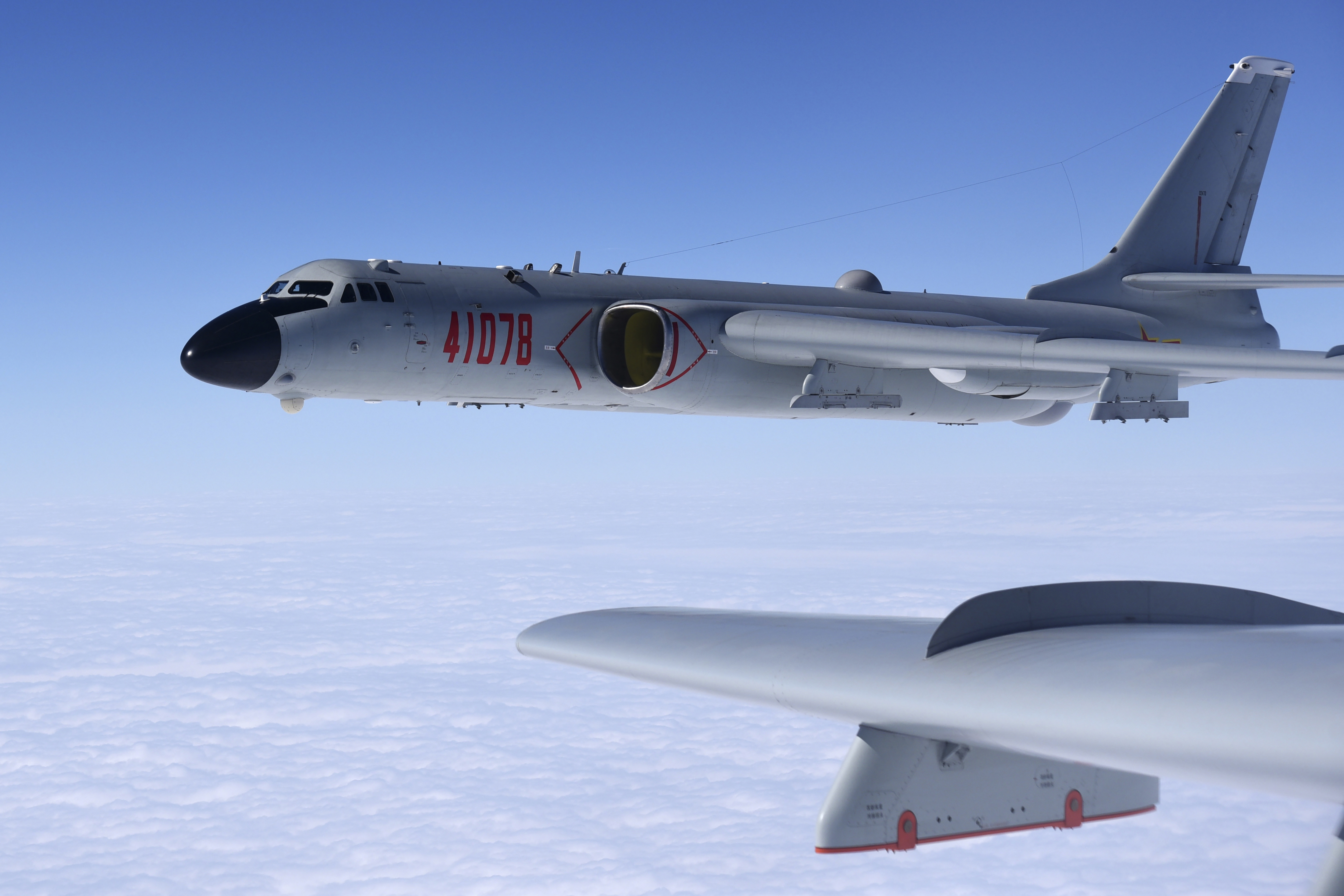 In this Nov. 23, 2017, photo released by Xinhua News Agency, a Chinese military H-6K bomber is seen conducting training exercises, as the People's Liberation Army (PLA) air force conducted a combat air patrol in the South China Sea. With record numbers of military flights near Taiwan over the last week, China has been stepping up its harassment of the island it claims as its own, showing an new intensity and sophistication as it asserts its territorial claims in the region.