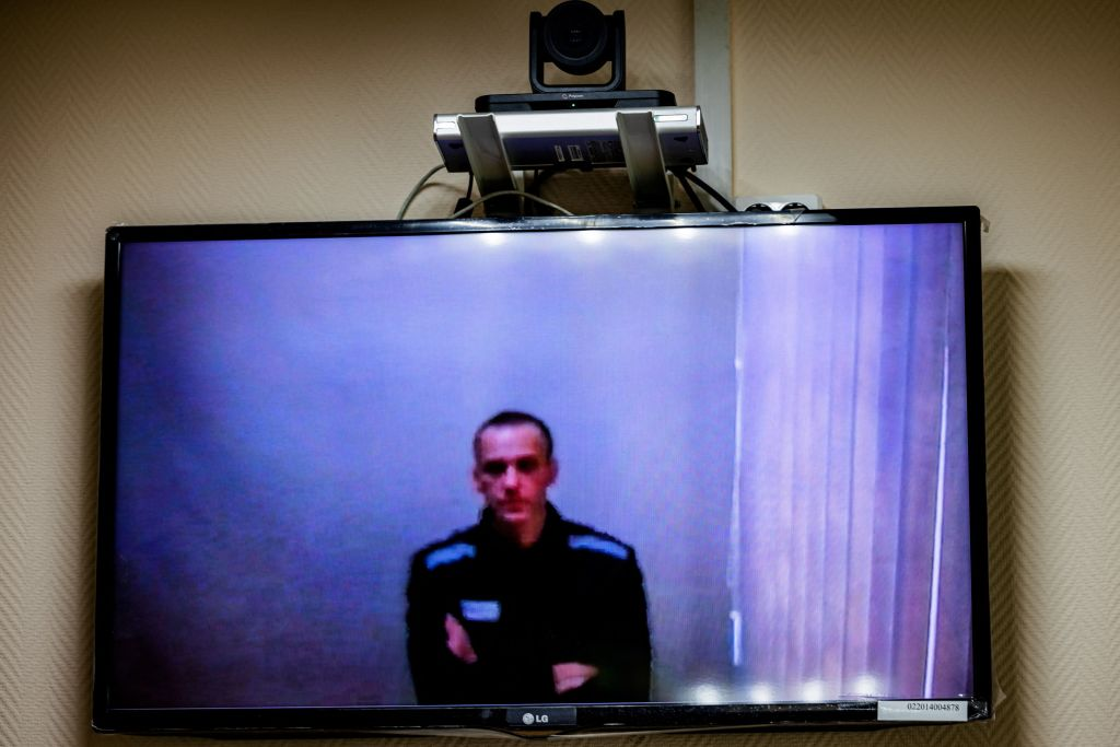 Jailed Kremlin critic Alexei Navalny appears on screen via a video link from prison during a court hearing, at a court in the town of Petushki some 120 kilometres outside Moscow, on May 26, 2021.