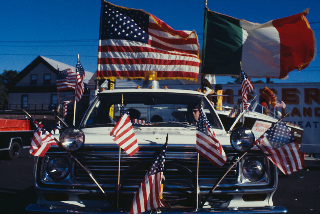 A car adorned with American and Italian flags at a Columbus Day Parade in Medford, Mass., in 1978.