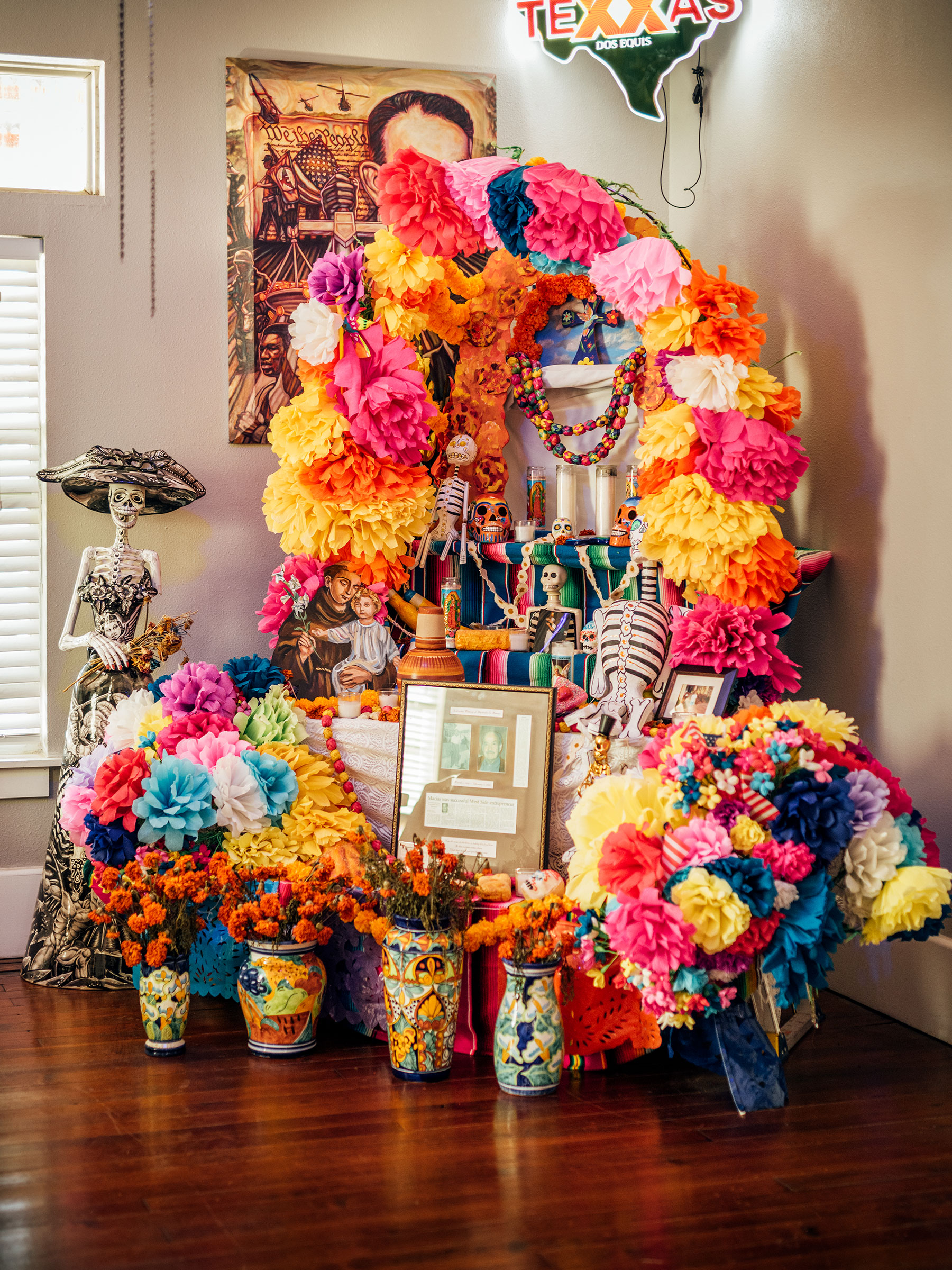 An altar, designed by artist Ana Laura Hernandez, is on display at Jaime's Place for community members to bring  ofrendas  or offerings for Dia de los Muertos, or Day of the Dead.