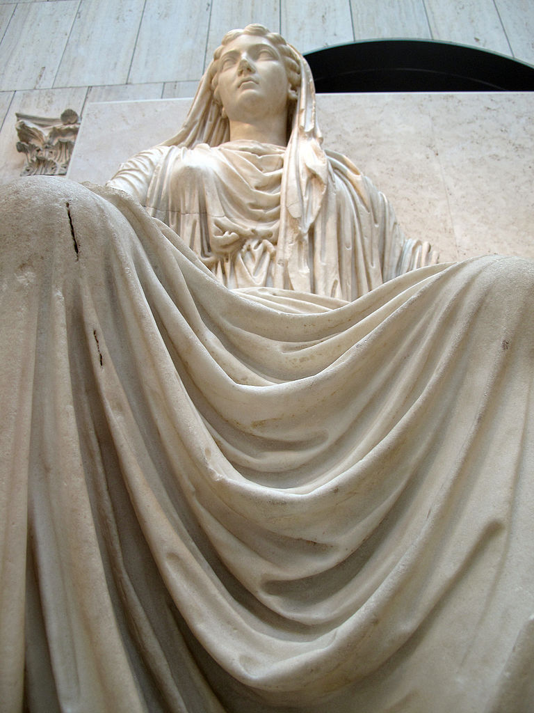 Sitting statue of Livia Drusilla, wife of the Emperor Augustus, a Roman sculpture of the early first century. National Archaeological Museum In Madrid.