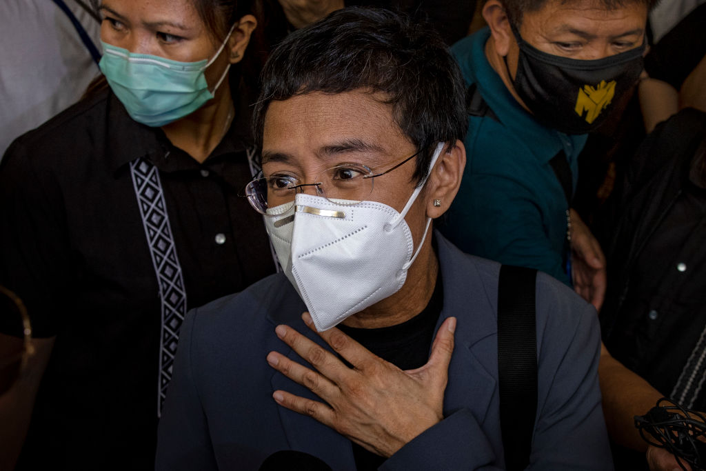 Maria Ressa, editor and CEO of Rappler, speaks to reporters after being convicted for cyber libel at a regional trial court on June 15, 2020 in Manila, Philippines.