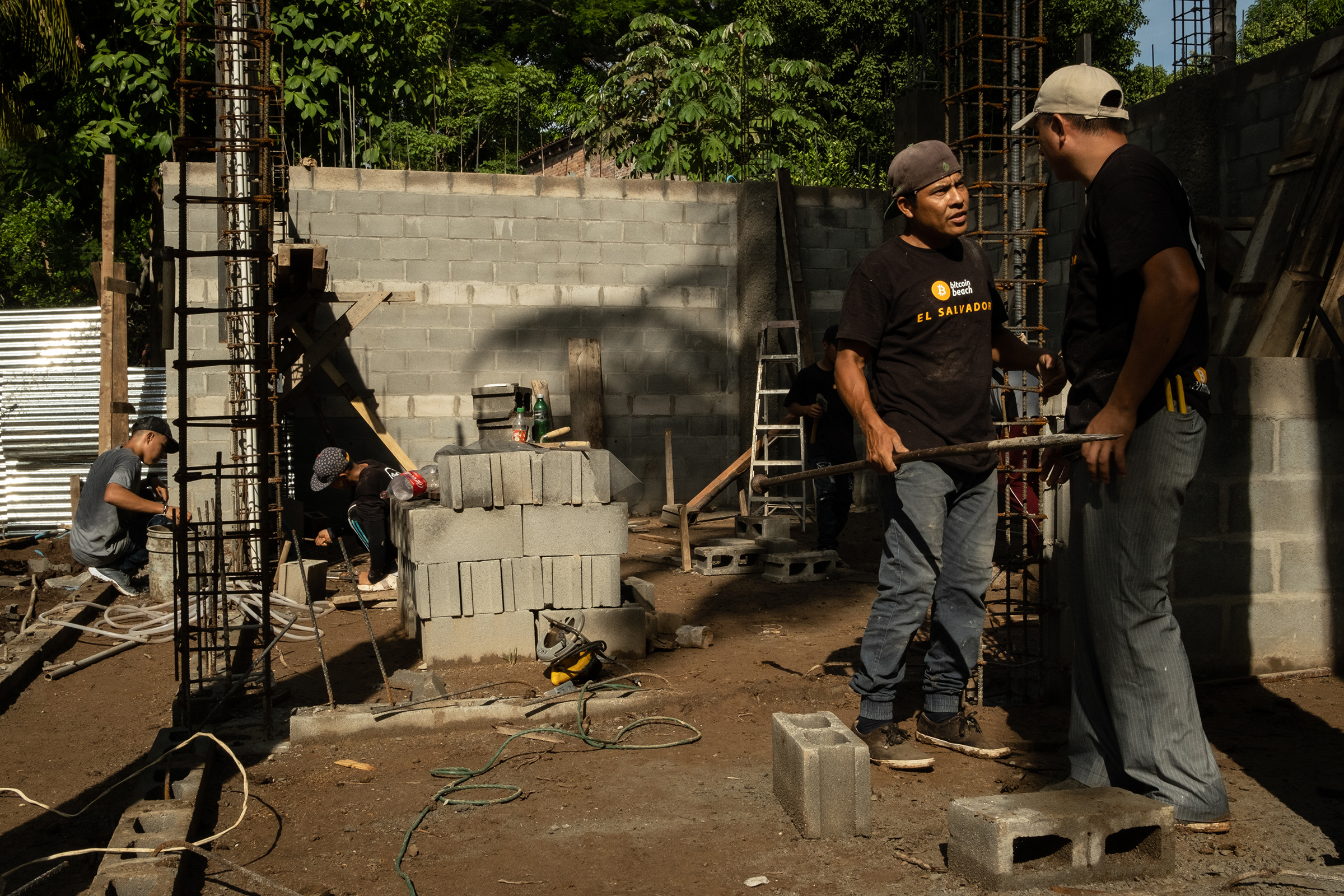 Construction workers, who are paid in bitcoin, work on a building outside the  bitcoin beach  office in El Zonte, El Salvador, on June 14, 2021.