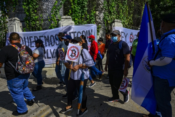 Demonstrators hold signs during a protest against President Bukele and bitcoin in San Salvador on Sept. 15, 2021.