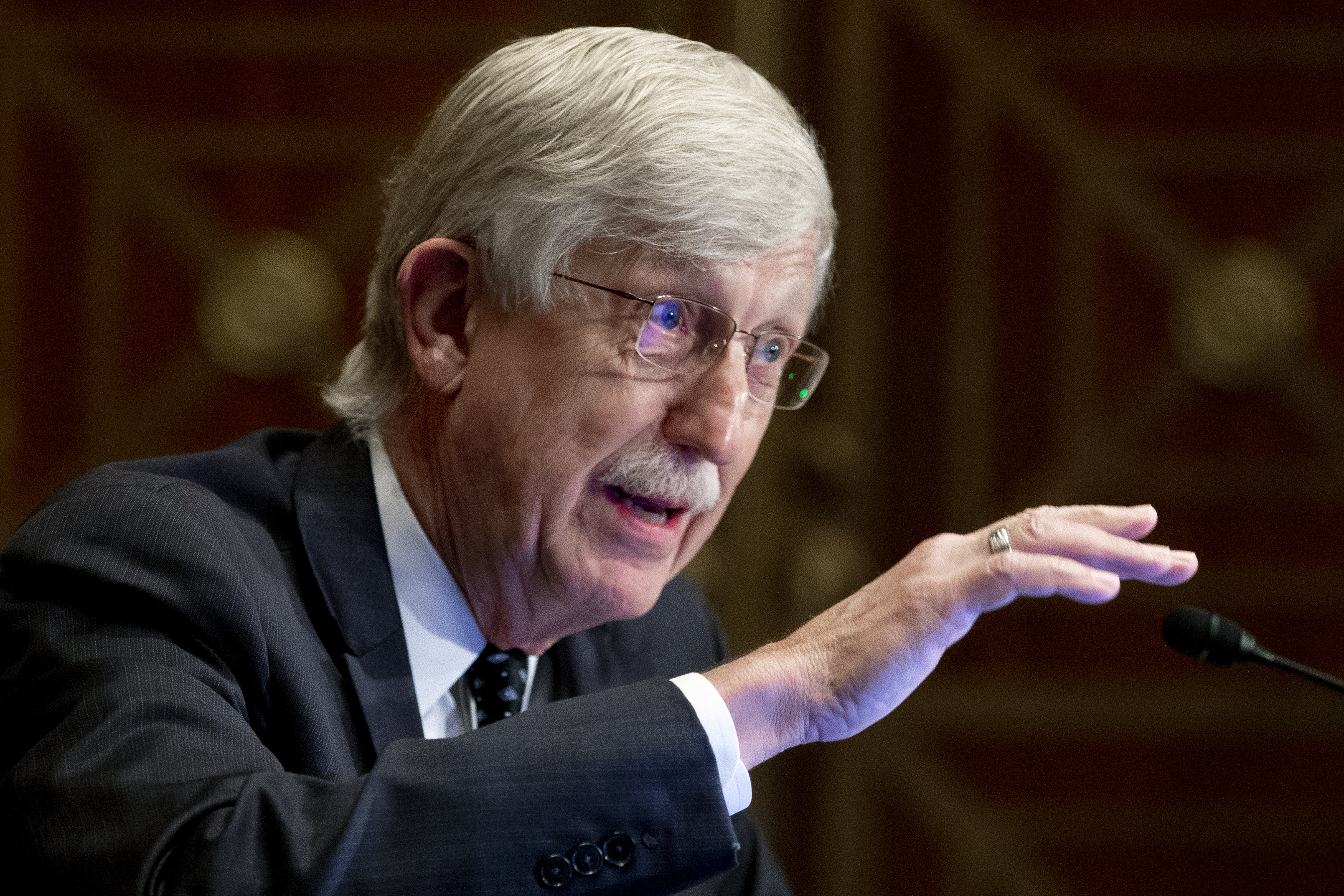 FILE - Dr. Francis Collins, director of the National Institutes of Health, appears before a Senate Health, Education, Labor and Pensions Committee hearing to discuss vaccines and protecting public health during the coronavirus pandemic on Capitol Hill, on Wednesday, Sept. 9, 2020, in Washington. Collins says he is stepping down by the end of the year, having led the research center for 12 years and becoming a prominent source of public information during the coronavirus pandemic. A formal announcement was expected Tuesday, Oct. 5, 2021 from NIH. (Michael Reynolds/Pool via AP, File)