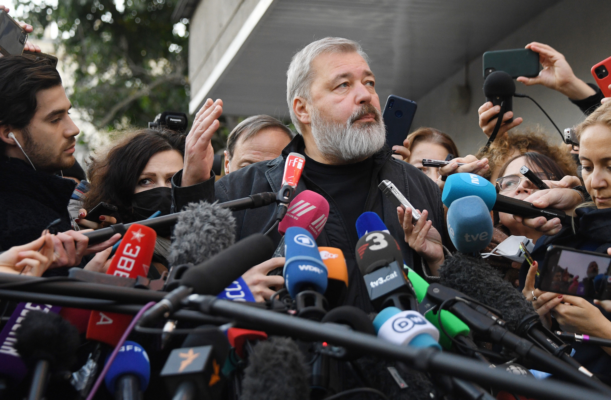 """Dmitry Muratov speaks at a news conference following the announcement of his Nobel Peace Prize win on October 8, 2021 in Moscow. Muratov was one of the founders of the independent Russian newspaper Novaya Gazeta, which the Nobel committee called """"the most independent newspaper in Russia today, with a fundamentally critical attitude towards power."""""""