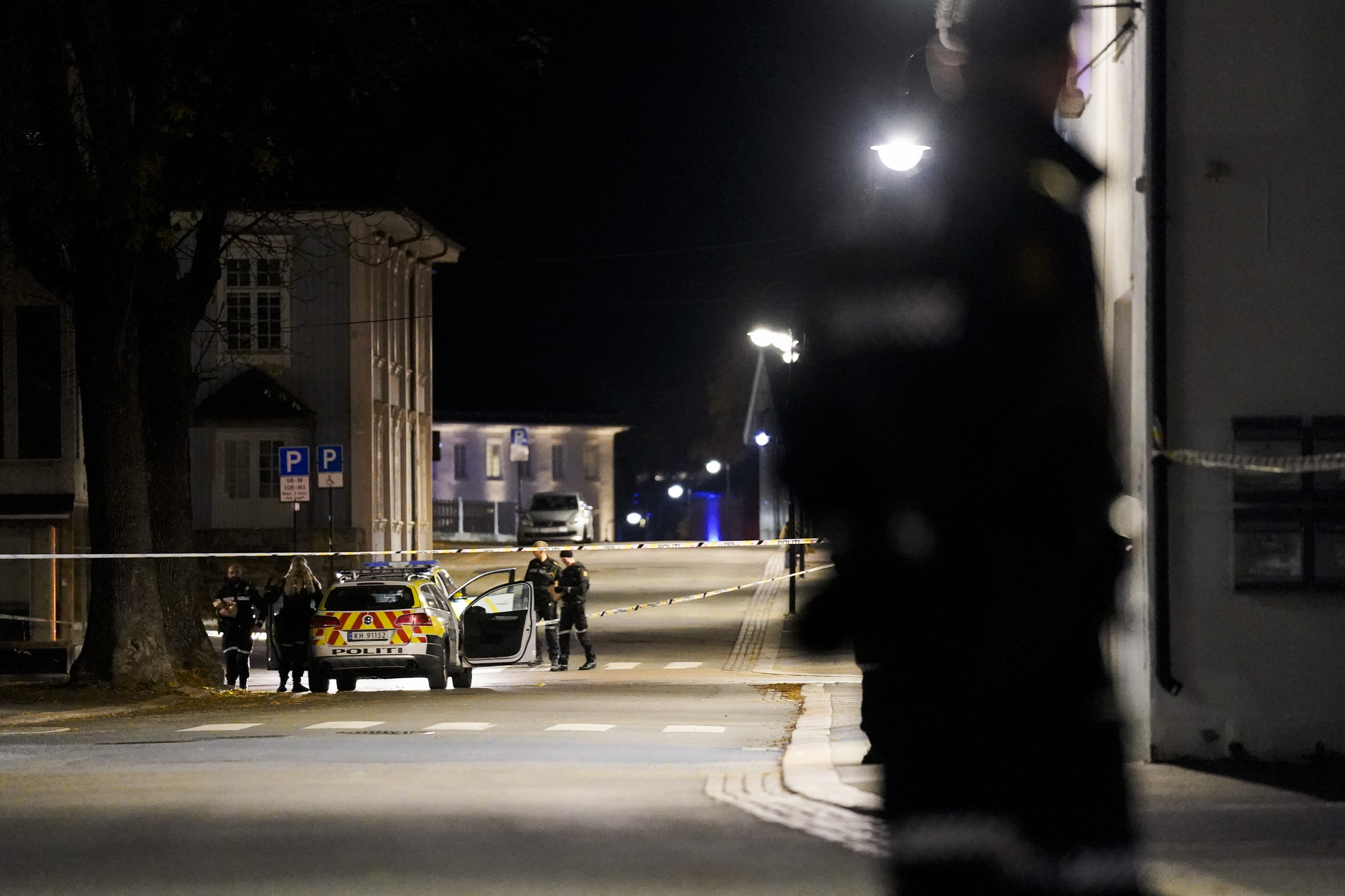 Police at the scene after an attack in Kongsberg, Norway, on Oct. 13, 2021.