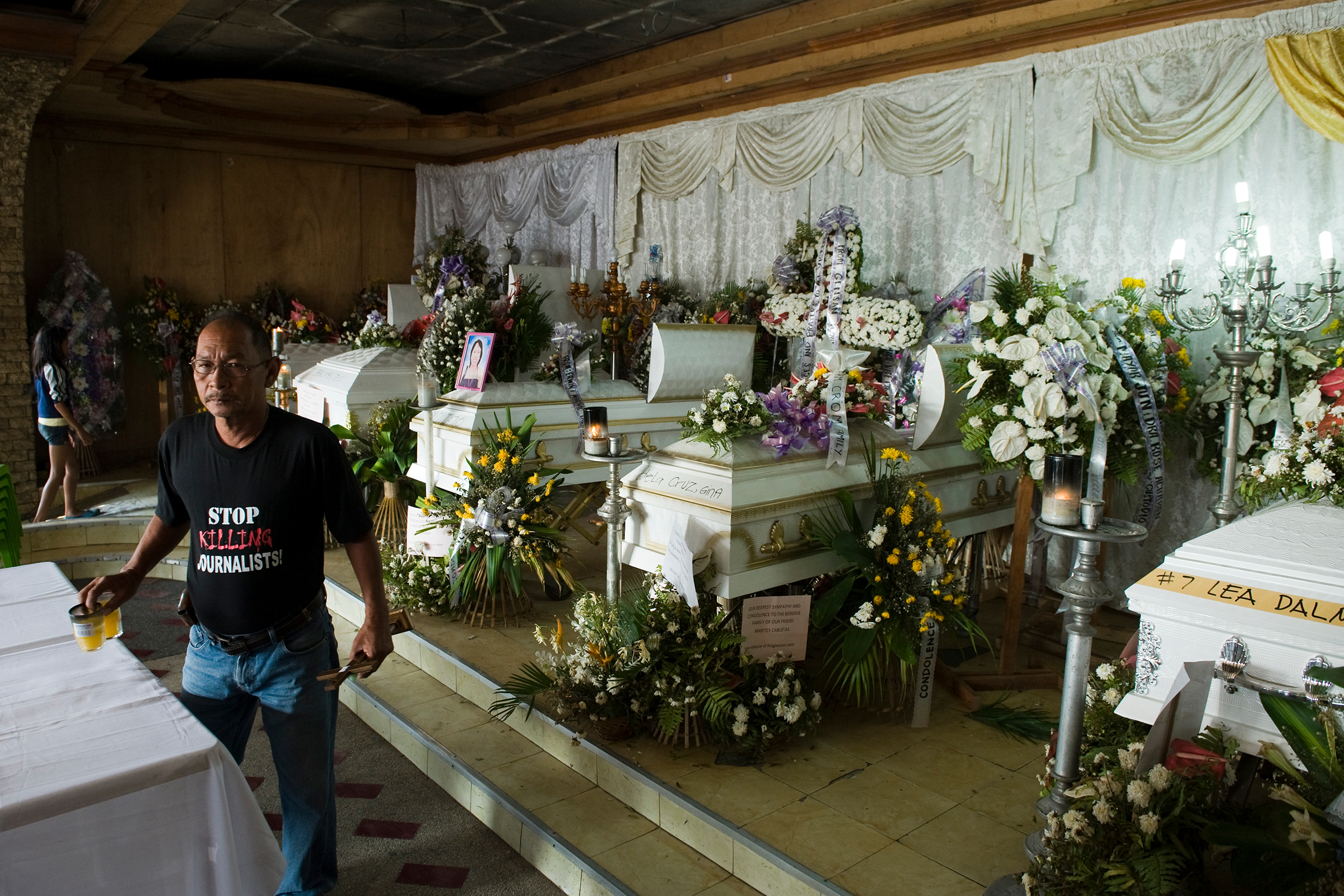 A wake for murdered journalists at the Collado Funeral Home in General Santos City, Mindanao, in 2009.