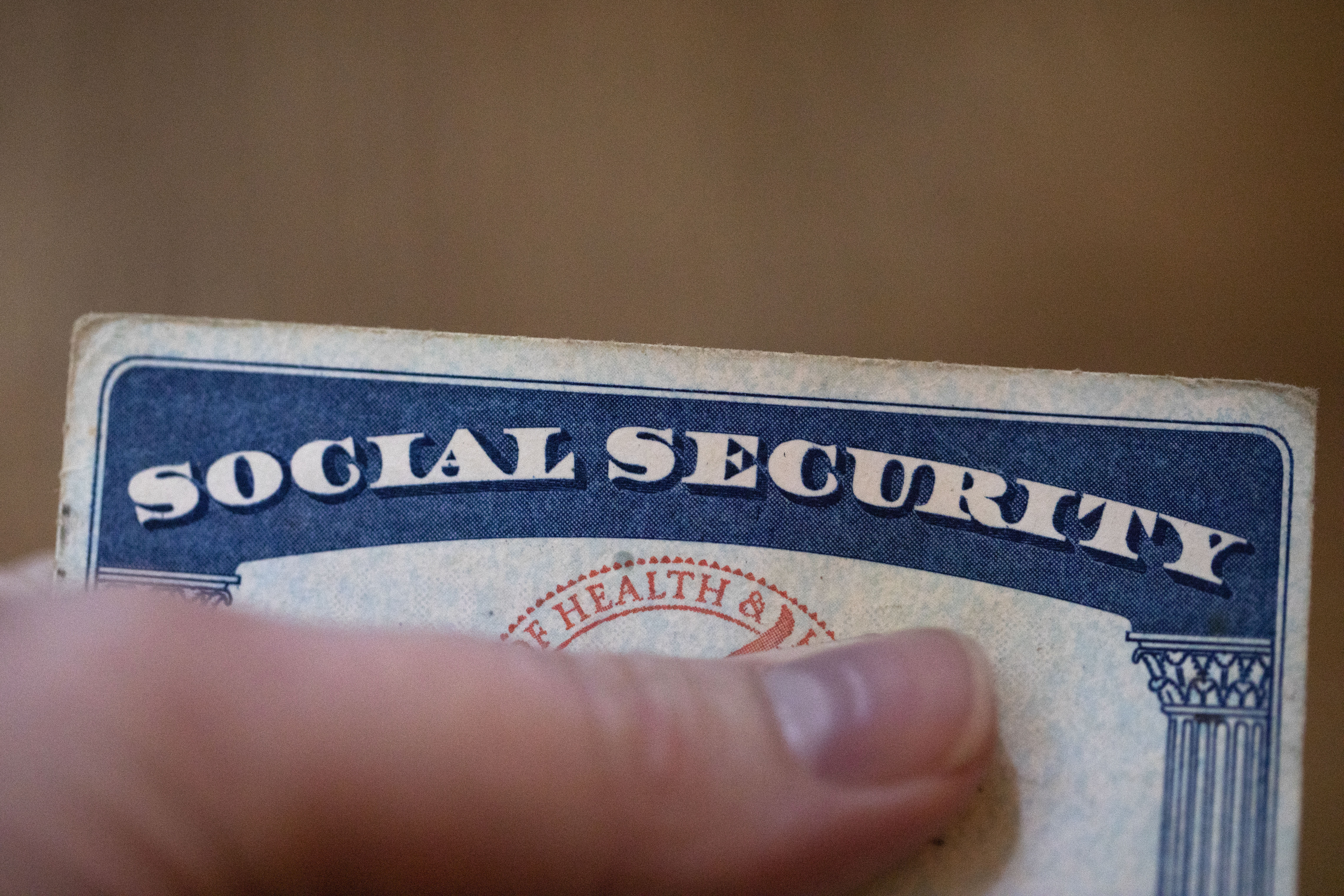 This Tuesday, Oct. 12, 2021, photo shows a Social Security card in Tigard, Ore.