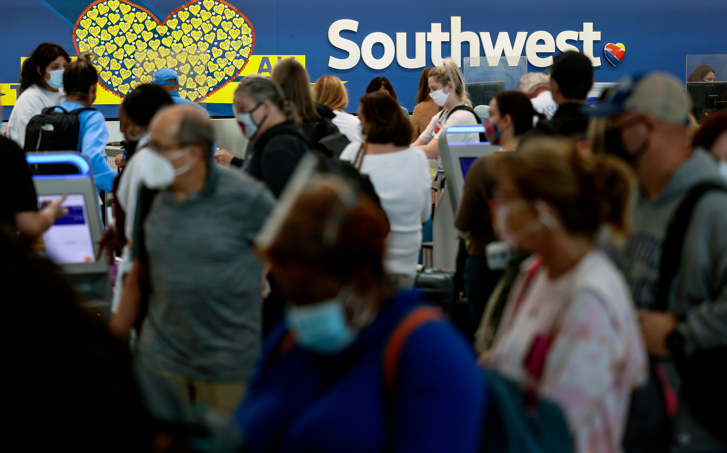 """Southwest Airlines, which is headquartered in Dallas, is among the businesses that have said they will continue to require vaccination, telling TIME they feel the federal action """"supersedes"""" state laws."""