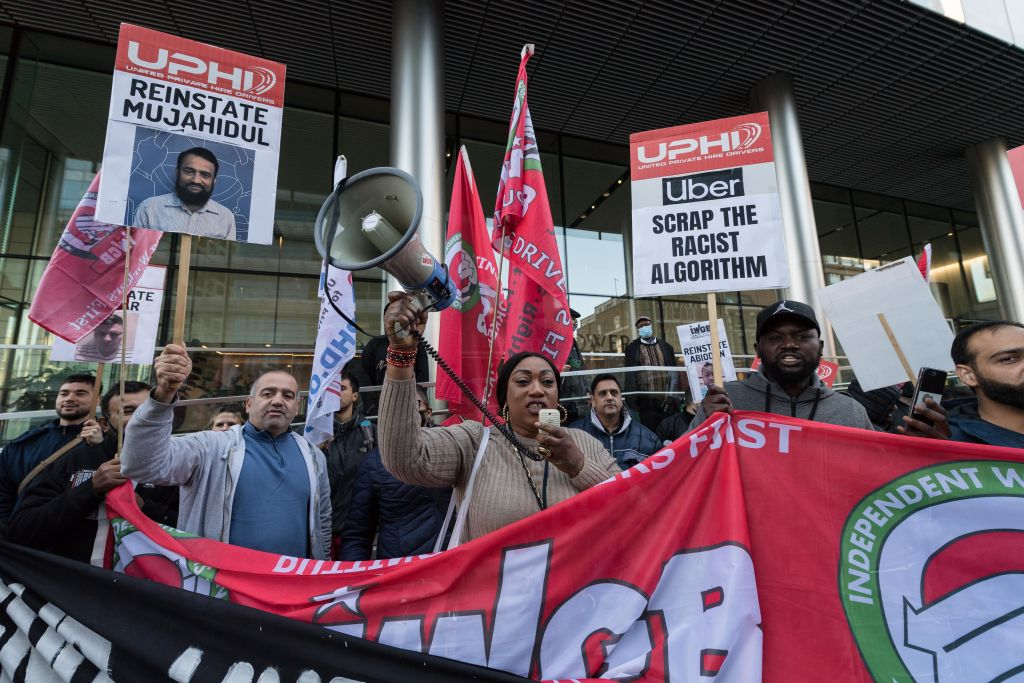 Uber drivers stage a protest outside the company's London HQ during a 24-hour strike action demanding better rates per mile with no fixed rate trips, reduction in Uber's commission to 15%, an end to the use of allegedly  racist  facial identification software and reinstatement of unfairly deactivated drivers on Oct. 6 2021 in London, England.