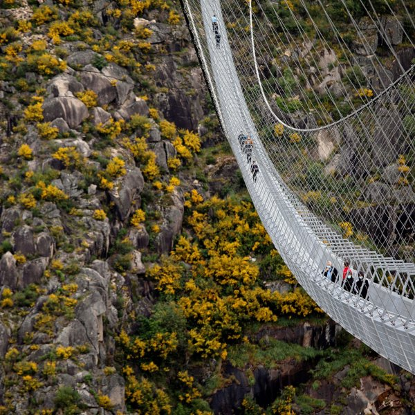 People walk on the world's longest pedestrian suspension bridge '516 Arouca', now open for local residents in Arouca, Portugal, April 29, 2021.